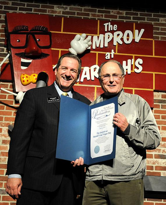 Harrah's Las Vegas President Rick Mazer presents Improv Founder Budd Friedman with proclamation naming April 30th The Improv at Harrah's Las Vegas Day