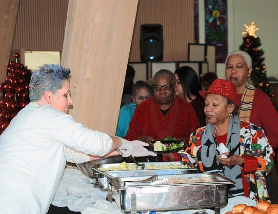 Helping Hands feeding seniors at holiday lunch