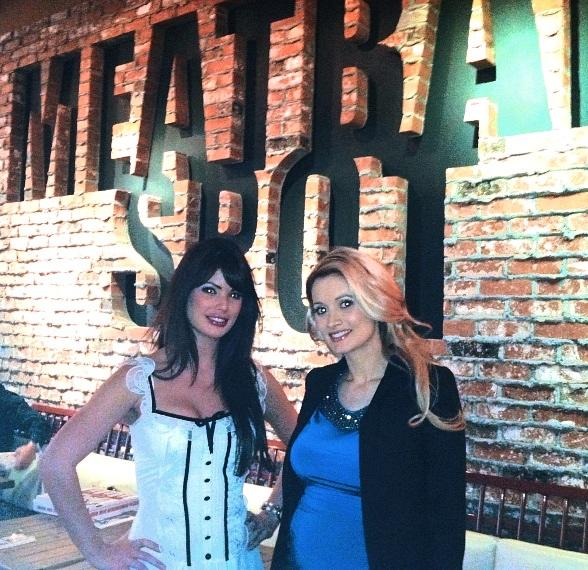 Holly Madison and Laura Croft Pose Under Meatball Spot Sign