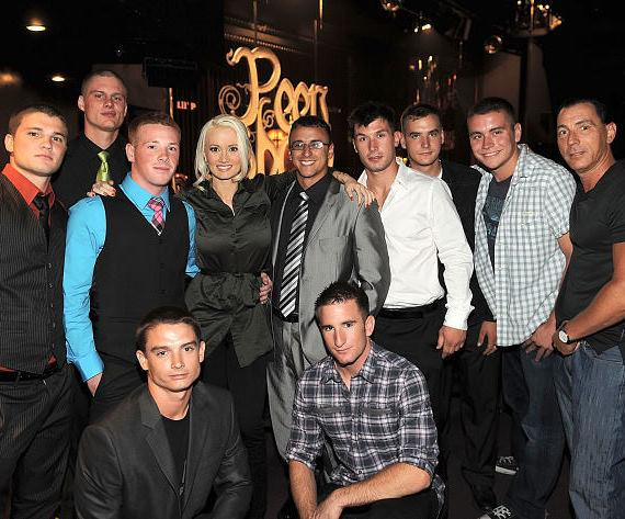 "Holly Madison (3rd from L) and Steve Davidovici (R) pose for photos with U.S. Marines at ""Peepshow"" at Planet Hollywood Resort & Casino on July 18, 2011 in Las Vegas, Nevada."