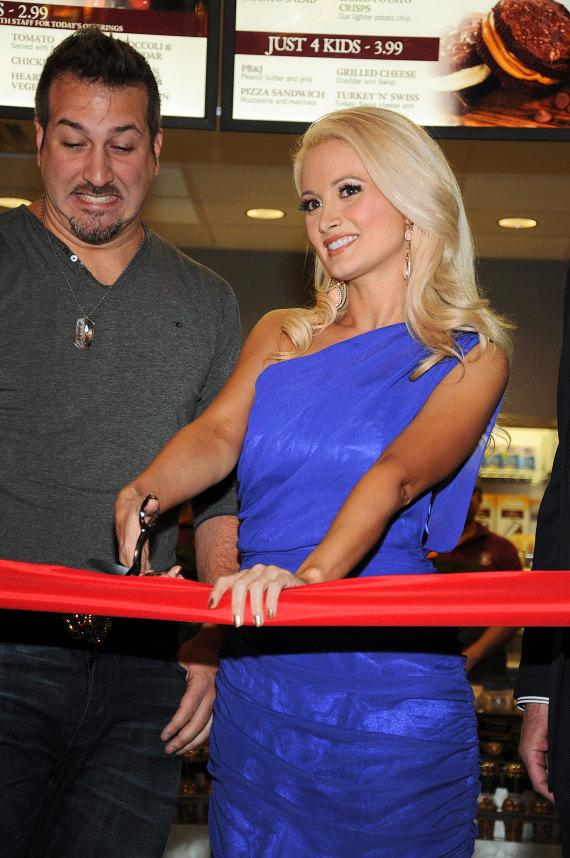 Joey Fatone looks on as Holly Madison cuts the ribbon at the Opening of Earl of Sandwich at Palms Casino Resort
