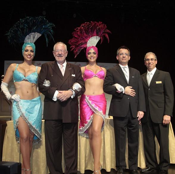 Honorary Oscar Goodman, John, Gaston Isoldi and John Caparella pose with showgirls