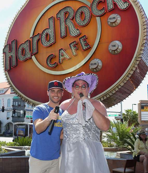 Host Josh Strickland poses with Brunch Leading Lady, Kitty Litter