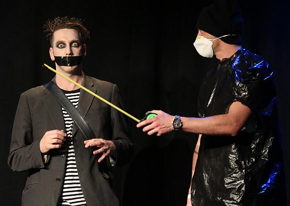 Tape Face performs with audience member at Harrah's Las Vegas