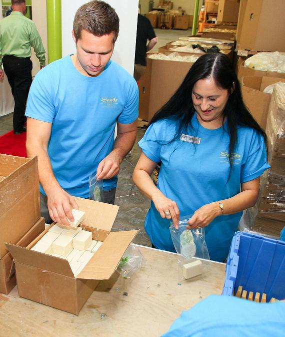 Volunteers build Hygiene Kits for disaster victims