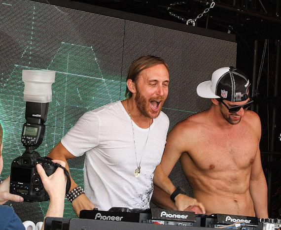 David Guetta and Michael Phelps in DJ booth at Encore Beach Club