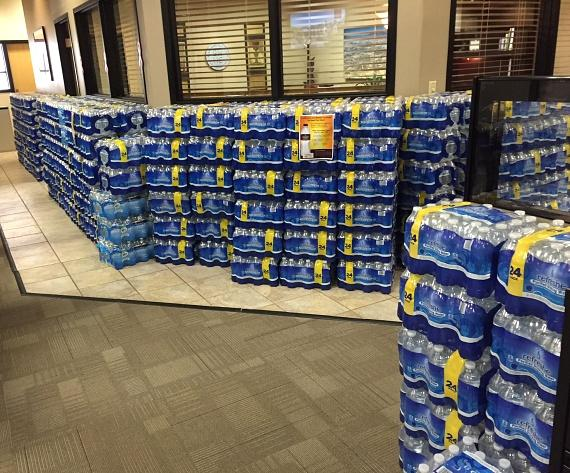 Bottled water donations line the halls of Berkshire Hathaway HomeServices Nevada Properties