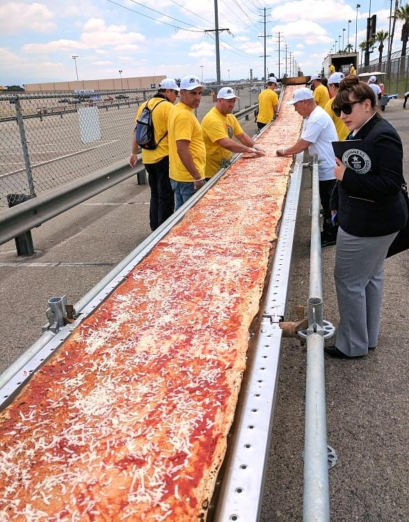 Guinness World Records Verifies John Arena and Team Made World's Longest Pizza