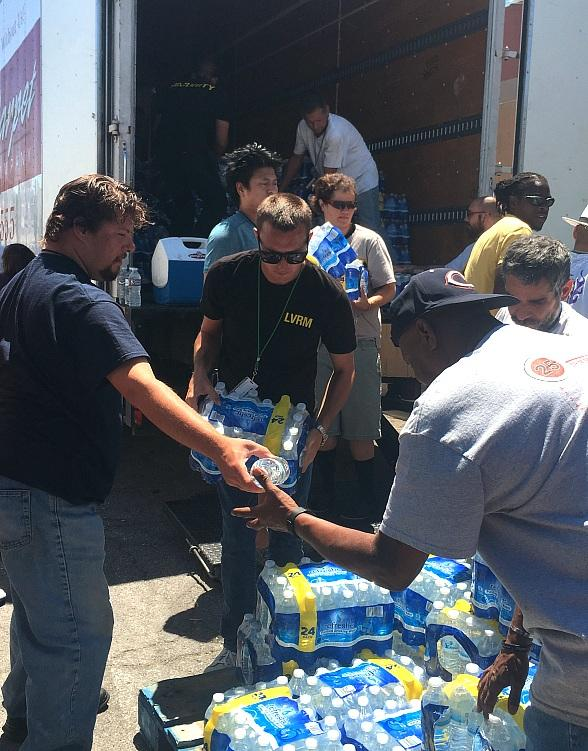 Volunteers deliver 44,000 bottles of water to the Las Vegas Rescue Mission