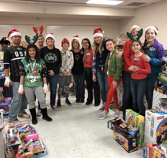 """""""Santa's helpers"""" at Catholic Charities Annual Christmas Toy Giveaway 2018"""