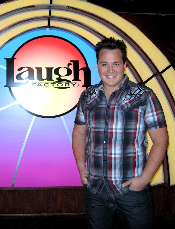 Michael Turco poses by the Laugh Factory sign in MURRAY 'Celebrity Magician'