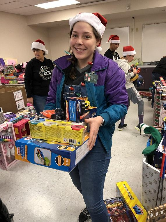 """One of """"Santa's helpers"""" at Catholic Charities Annual Christmas Toy Giveaway 2018"""