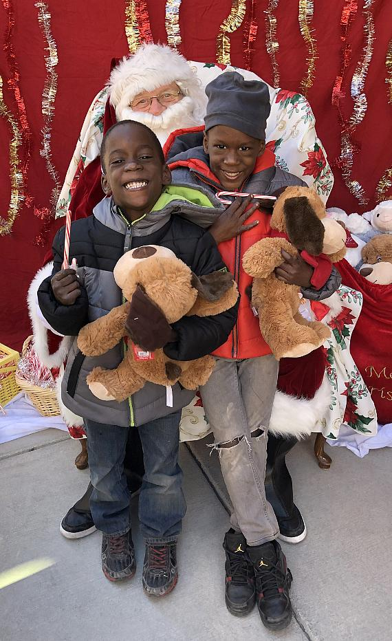 Kids with toys at Catholic Charities Annual Christmas Toy Giveaway 2018