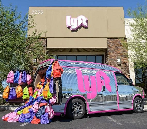 Lyft van loaded with backpacks