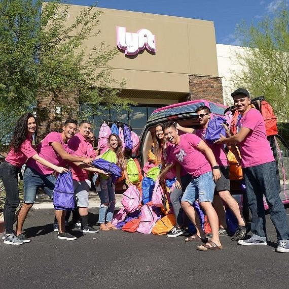 Lyft team with backpacks