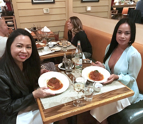 Dixie Miranda (R) with best friend Fa Wijitwan enjoy Chef Carla Pellegrino's signature spaghetti at Bratalian restaurant in Henderson