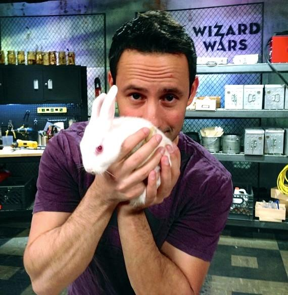 Wizard Wars creator/producer Rick Lax holds one of the Challenger Round's 'mystery objects' - a bunny rabbit