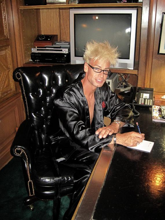 Murray SawChuck sits at Hugh Hefner's desk in his personal office at the Playboy Mansion