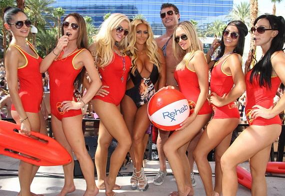 Aubrey O'Day with servers at Rehab at Hard Rock Hotel & Casino in Las Vegas