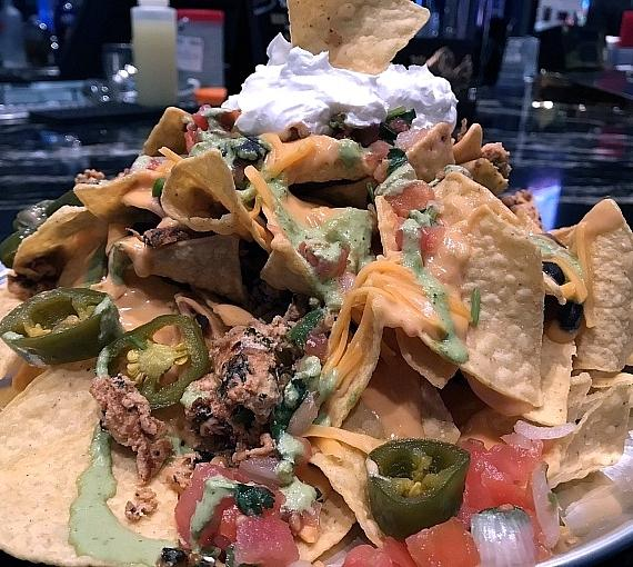Bar patrons can dine on avariety of plates including Gyros Bites,Bacon Cheddar Poutine Tater Kegs, Chicken Nachos, Korean Tacos, IndividualPizzas and BuffaloChicken Wings.