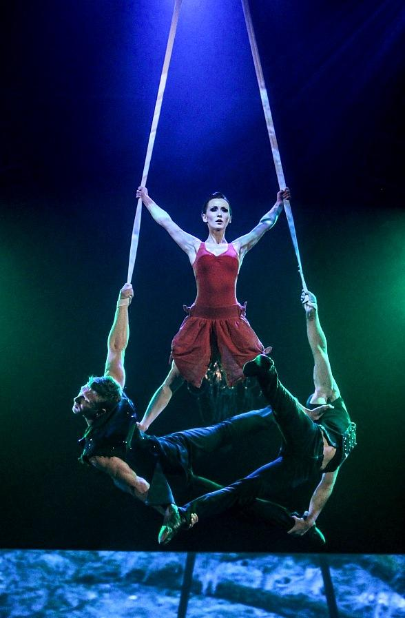 """Erica Linz balances atop Kyle DesChamp (left) and Pierre-Luc Sylvain during the Circus Couture """"Possession(s)"""" event held at The Joint inside Hard Rock Hotel"""