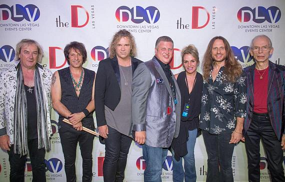 DLVEC owner Derek Stevens and wife Nicole Parthum pose backstage with YES Before the show.