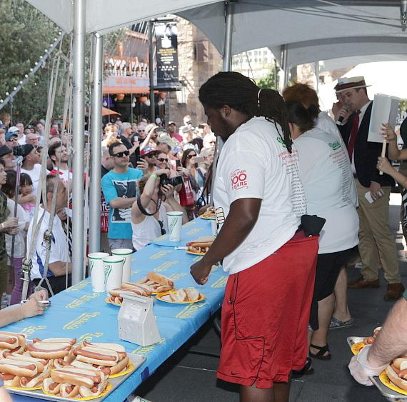 Competitors devour hot dogs at New York-New York Hotel & Casino