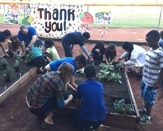 Children, volunteers, parents and Boys & Girls Clubs of Southern Nevada Staff dig in to plant vegetables, flowers and fruits