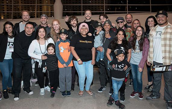 Imagine Dragons' Dan Reynolds, Dan Platzman, Wayne Sermon and Ben McKee, stand alongside Tyler Robinson Foundation (TRF) families, staff and board members at the February 13 Vegas Golden Knights game at T-Mobile Arena.