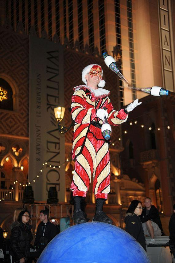 A juggler balances on a ball at The Venetian's Winter in Venice celebration
