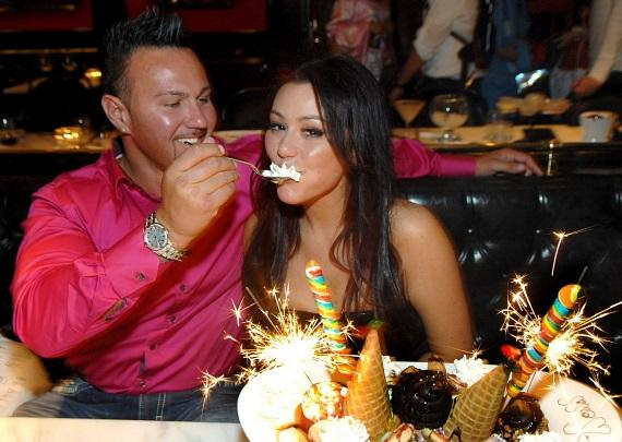 "Jennifer ""JWoww"" Farley and boyfriend Roger Matthews feed each other scoops of ice cream at Sugar Factory American Brasserie at Paris Las Vegas"