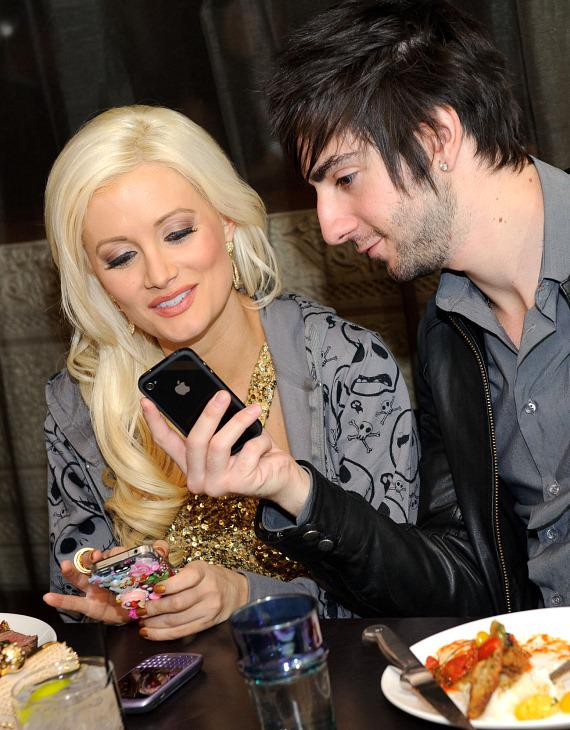 Jack Barakat shows Holly Madison something on his phone