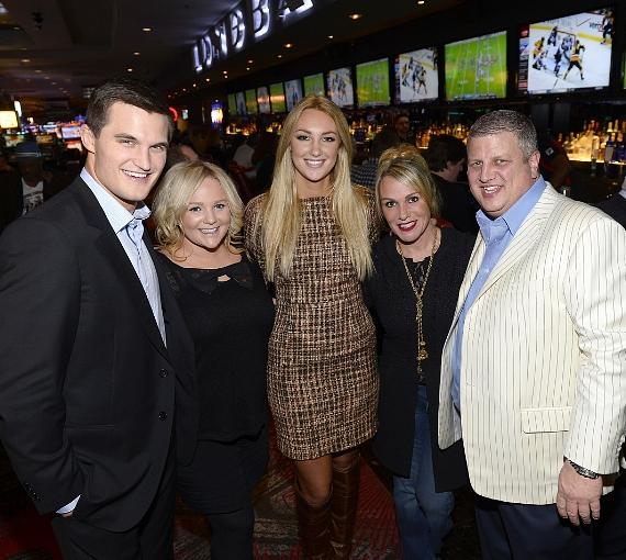 Jaclyn Schultz and Jon Misch pose with owner Derek Stevens and family at LONGBAR at the D