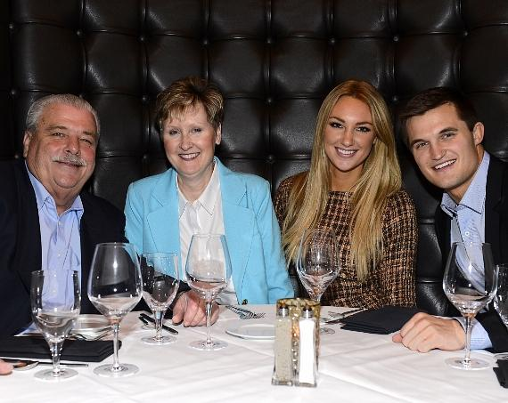 Jaclyn Schultz and Jon Misch pose with family at Andiamo at the D