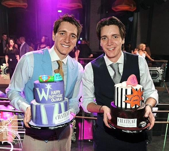 James and Oliver Phelps pose at Chateau Nightclub & Gardens. James and Oliver Phelps are presented with their birthday cakes at Chateau Nightclub at Paris Las Vegas