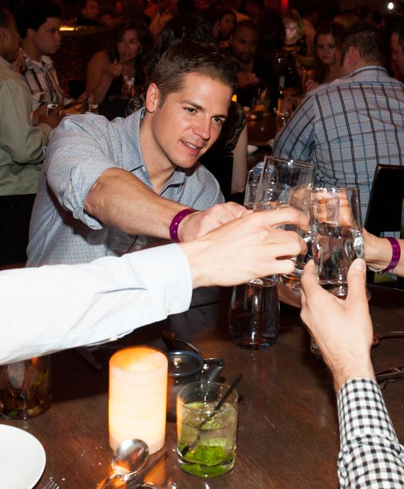 Jason Kennedy toasts with Whole World water at TAO
