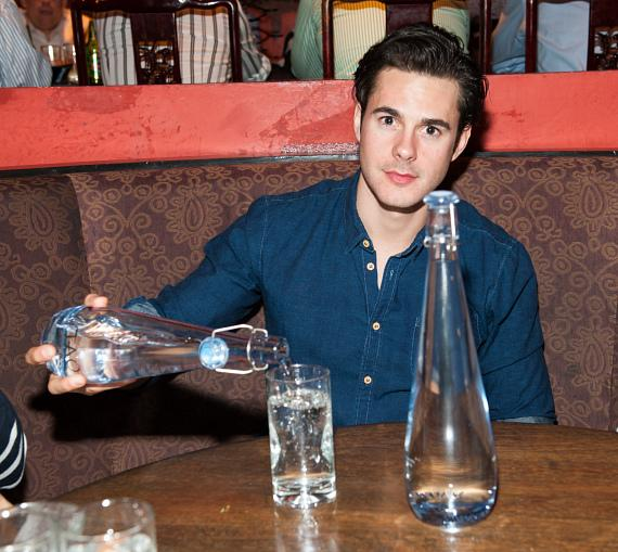 Jayson Blair pours Whole World water at TAO