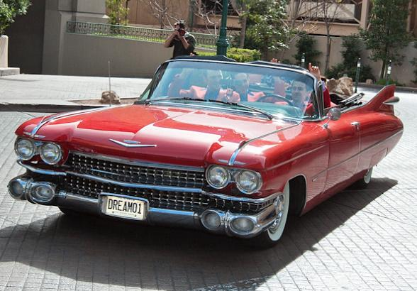 Jersey Boys arrive in 1959 red Cadillac Convertible