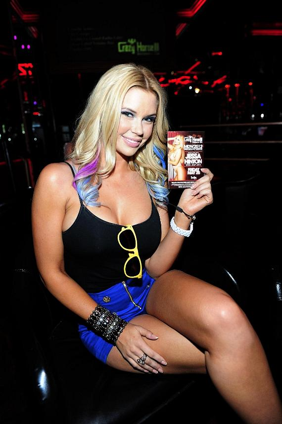 Jessa Hinton poses with event flyer