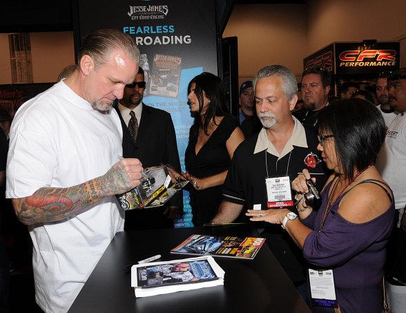 Jesse James signs autographcs at at SEMA Auto Show in Las Vegas