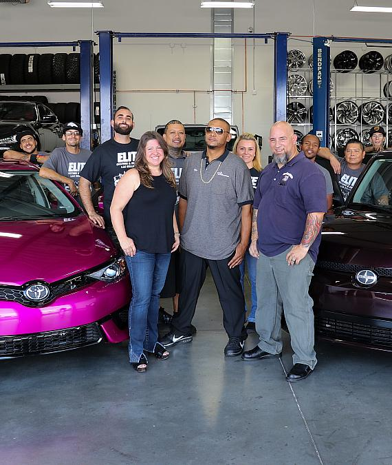 Lyft drivers Jilly Sentino and Tony Parham with Elite Audio Customs & Collision team