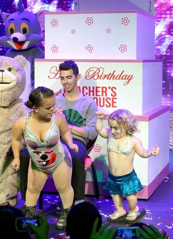 Joe Jonas with World's Smallest Stripper and Mini Miley Stripper