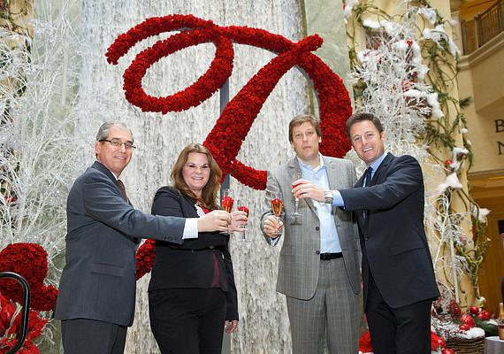 John Caparella, Dana Beatty, Peter de Mos and Chris Harrison toasting to The Palazzo Rose