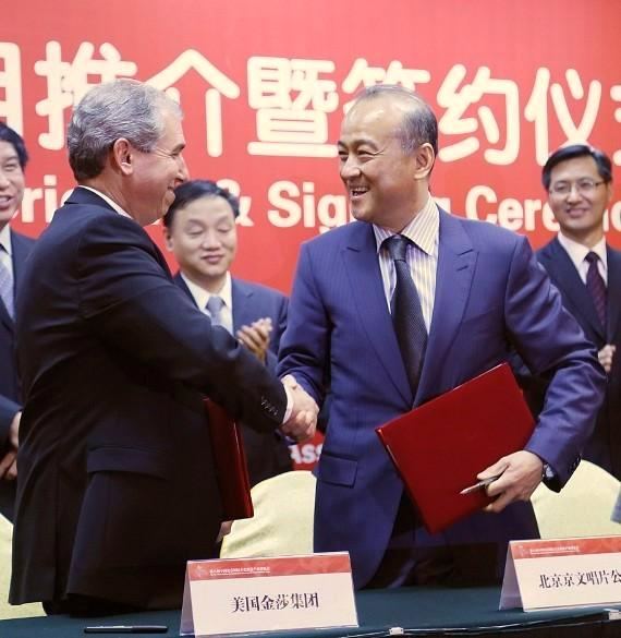 Government officials in Beijing look on as John Caparella (left), president and COO of The Venetian, The Palazzo, and Sands Expo, and An Zhao, the director of PANDA!, (right) sign ceremonious contract for the first-ever Chinese-produced show to take up a Las Vegas residency.
