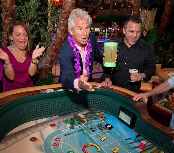 John Cohlan of Margaritaville Holdings rolls the first dice at Margaritaville Casino at the Flamingo