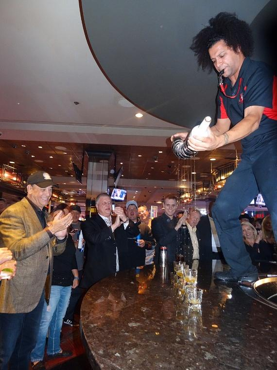 Jon Taffer is entertained by LONGBAR's flair bartender at the D Las Vegas