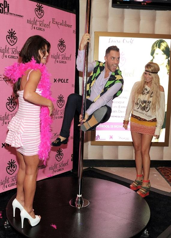 Laura Croft and Angel Porrino watch as Josh Strickland tries out the Night School 4 Girls pole