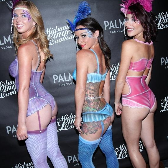 Julianna Barninger, Danielle Harris and Adrieanne Perez show off lingerie painted costumes painted on by local body painter, Kelly Belmonte, at Midsummer Lingerie Masquerade