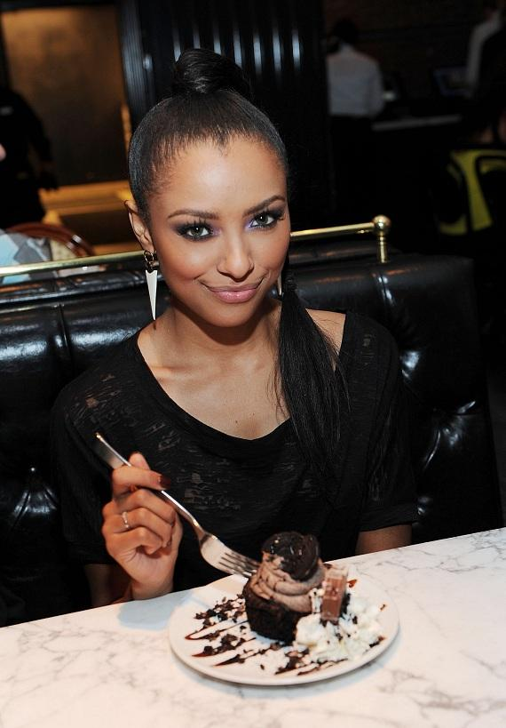 Kat Graham enjoys the Oreo Cookie Cupcake at Sugar Factory in Las Vegas