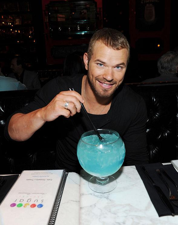 Kellan Lutz with an Oceans Blue goblet cocktail at Sugar Factory American Brasserie at Paris Las Vegas